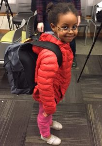 Photograph of young girl wearing Tech Tales Backpacks